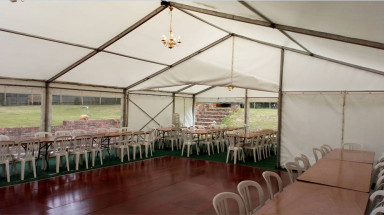 Unlined Marquee with Trestle Tables Seating
